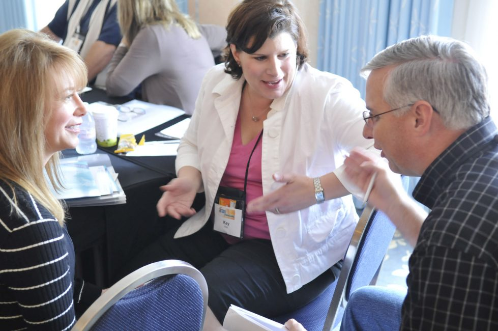 Delegates engaging in lively discussion during a breakout session