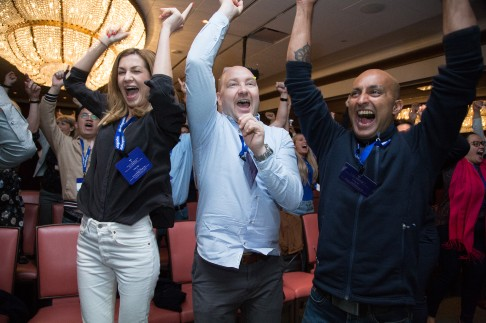 Course participants cheering and jumping